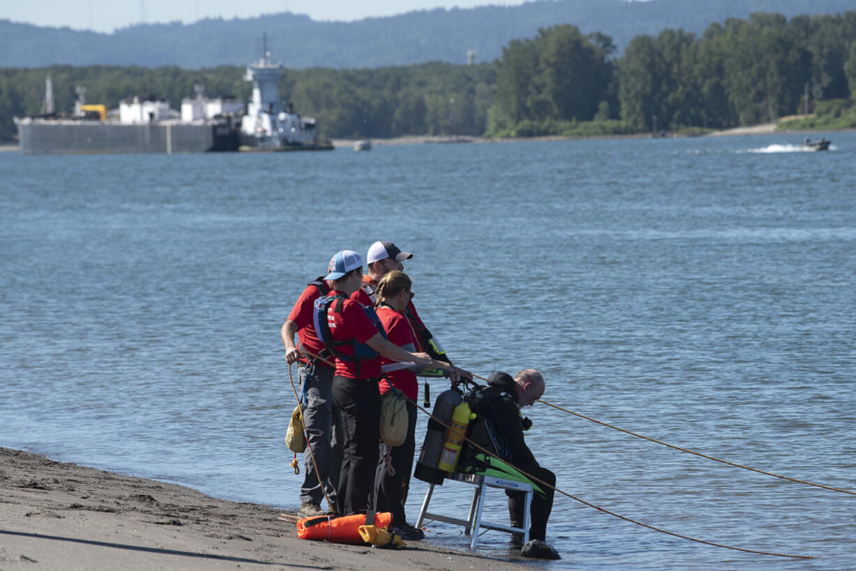 Officials work Monday morning to locate a man who is believed to have drowned near the Columbia River Frenchman's Bar Regional Park on Sunday evening. He was not wearing a life jacket and was not a strong swimmer, according to the Vancouver Fire Department.