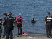 Divers search the waters off Frenchman's Bar Regional Park the morning after a man is believed to have drowned in the Columbia River on Sunday evening.