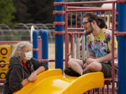 Vancouver Parks and Recreation staff member Karen Miller talks with Hayden Rider, 18, at an Access to Recreation camp at Lieser Elementary School in Vancouver. The camps for individuals with special needs are back on this summer after the pandemic forced a hiatus in 2020.