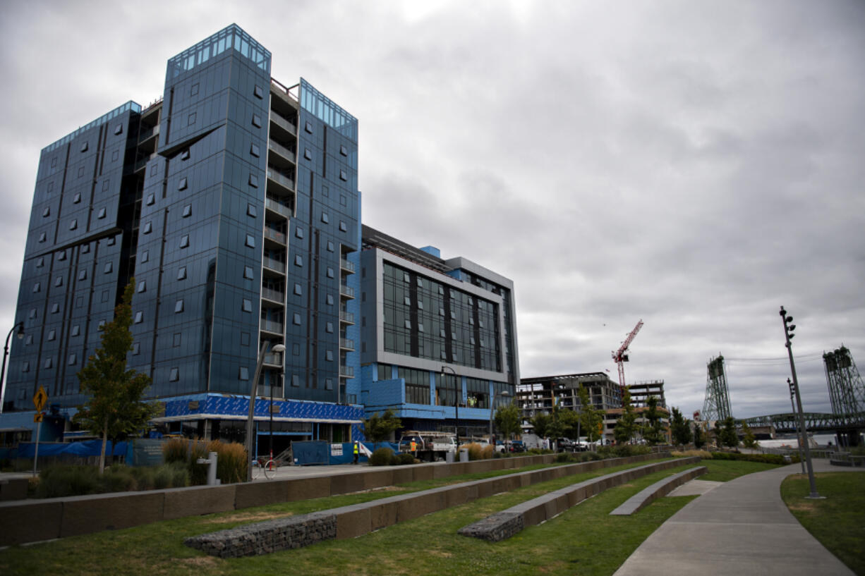 Kirkland Tower, left, the nearly completed condo tower at The Waterfront Vancouver, is pictured with Hotel Indigo at The Waterfront Vancouver on Tuesday morning. The two projects from Vancouver-based Kirkland Development are being built together but will function as separate buildings.