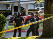 Law enforcement officers investigate the scene of a reported shooting at The Pointe Apartments on Friday evening, July 23, 2021.