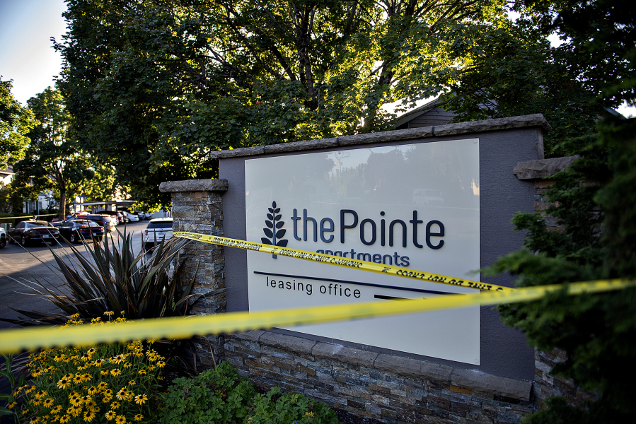Law enforcement officers investigate the fatal shooting of Clark County sheriff's Detective Jeremy Brown at The Pointe Apartments on Friday evening.