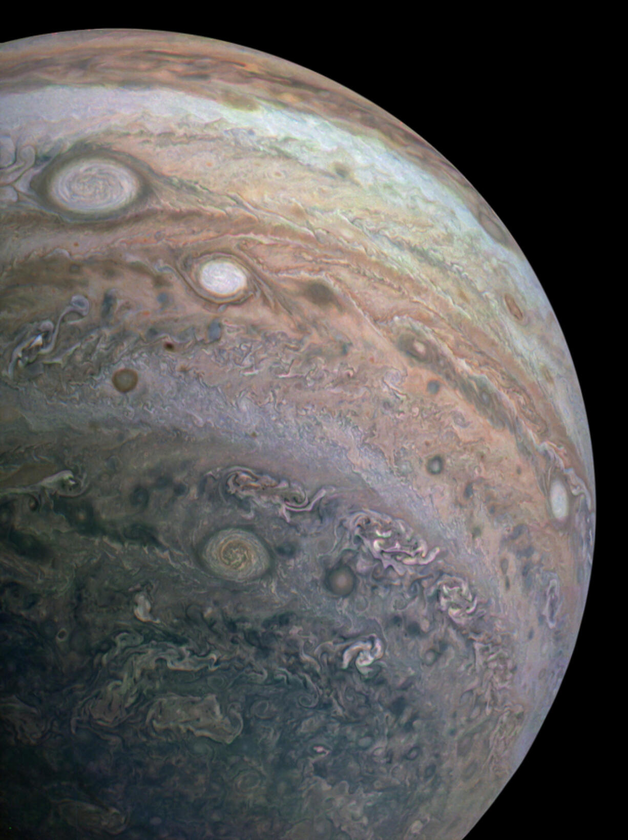 A Juno space probe passed below Jupiter and took this photograph of the giant planet's cloud bands on April 10, 2020.