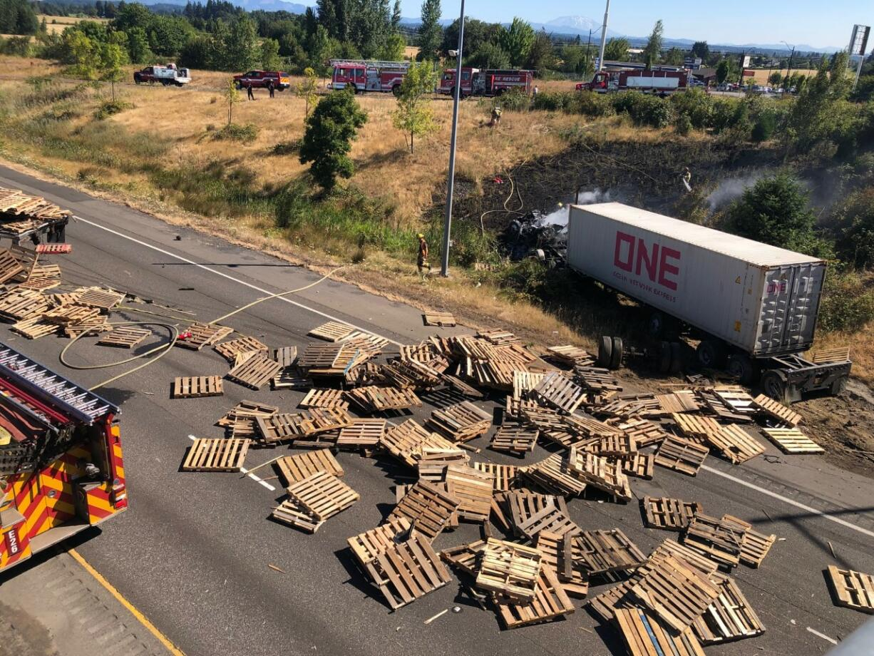 Two semis were involved in a crash on I-5 on Monday morning in the backup from an earlier crash on the Lewis River Bridge. One person was injured in the crash involving the semis.