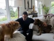 Abraham Dairi spends time with his dogs Ziggy, 3, and Bowie, 4, at his home in Seattle's Montlake neighborhood on July 1, 2021. After the death of his wife, Holly Deierling, in September of 2020, Dairi pushed state lawmakers to provide more resources to people in crisis, including through a bill that will set up a new suicide prevention hotline. (Matt M.