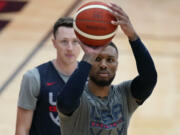 Damian Lillard shoots during practice for USA Basketball, Wednesday, July 7, 2021, in Las Vegas.