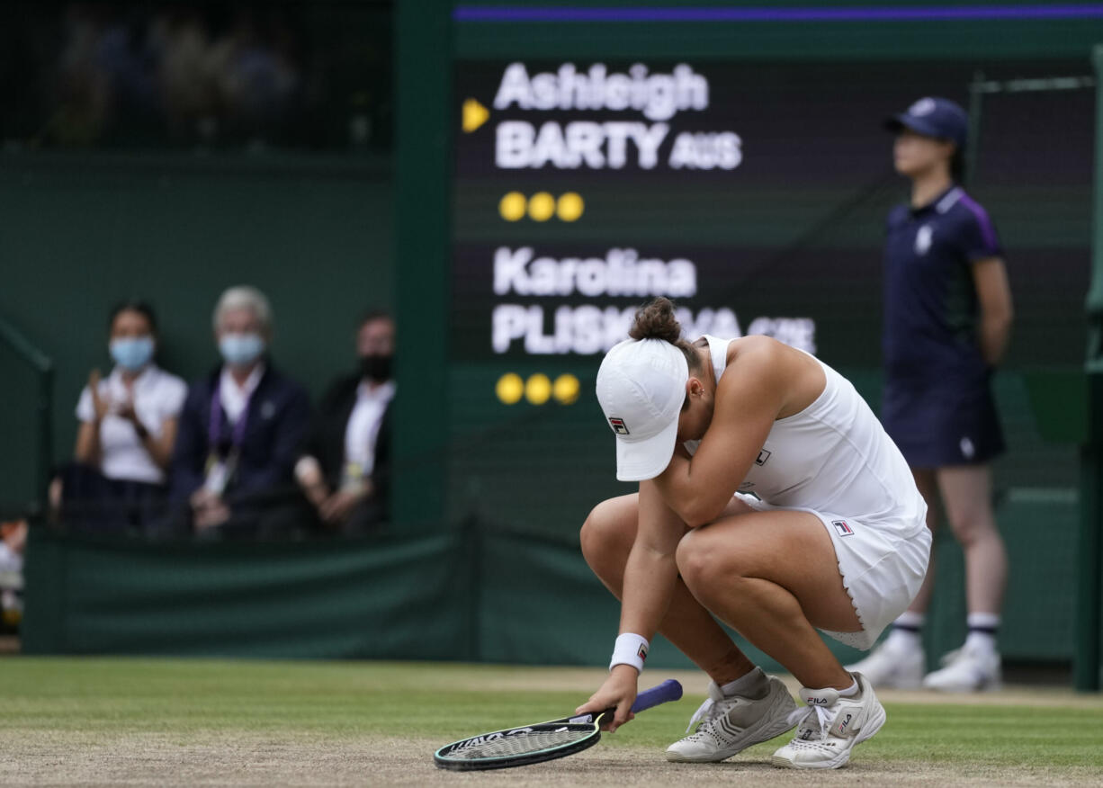 Australia's Ashleigh Barty reacts after defeating the Czech Republic's Karolina Pliskova in the women's singles final on day twelve of the Wimbledon Tennis Championships in London, Saturday, July 10, 2021.