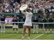 Australia's Ashleigh Barty poses with the trophy for the media after winning the women's singles final, defeating the Czech Republic's Karolina Pliskova on day twelve of the Wimbledon Tennis Championships in London, Saturday, July 10, 2021.