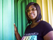 Tamika Daniel poses for a photo in Richmond, Va., Thursday, July 15, 2021. Daniel, a 35-year-old mother of four, will start receiving the Child Tax Credit on Thursday. The extra $1,000 a month for the next year could be a life-changer for Daniel, who now works as a community organizer for a Richmond nonprofit. It will help provide a security deposit on a new apartment. (AP Photo/John C.