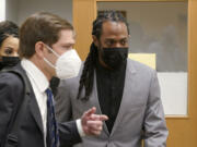 NFL football player Richard Sherman, right, heads into a hearing at King County District Court with his attorney Cooper Offenbecher, Friday, July 16, 2021, in Seattle. Prosecutors in Washington state have charged Sherman, who has played for the Seattle Seahawks and the San Francisco 49ers NFL football teams, after police said he drunkenly crashed his SUV in a construction zone and tried to break into his in-laws' home. (AP Photo/Ted S.