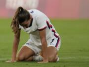 United States' Tobin Heath reacts after losing 3-0 against Sweden during a women's soccer match at the 2020 Summer Olympics, Wednesday, July 21, 2021, in Tokyo.