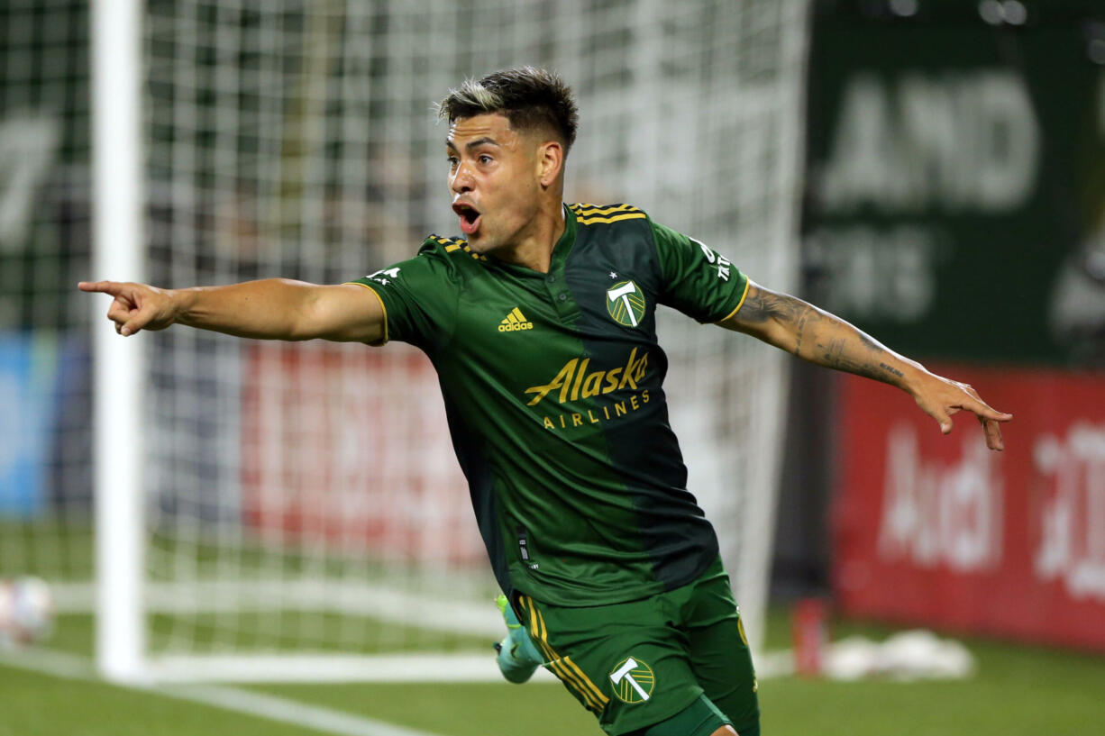 Portland Timbers forward Filipe Mora celebrates his header for a goal in extra time to give the Timbers a 2-1 win over Los Angeles FC in an MLS soccer match Wednesday, July 21, 2021, in Portland, Ore.