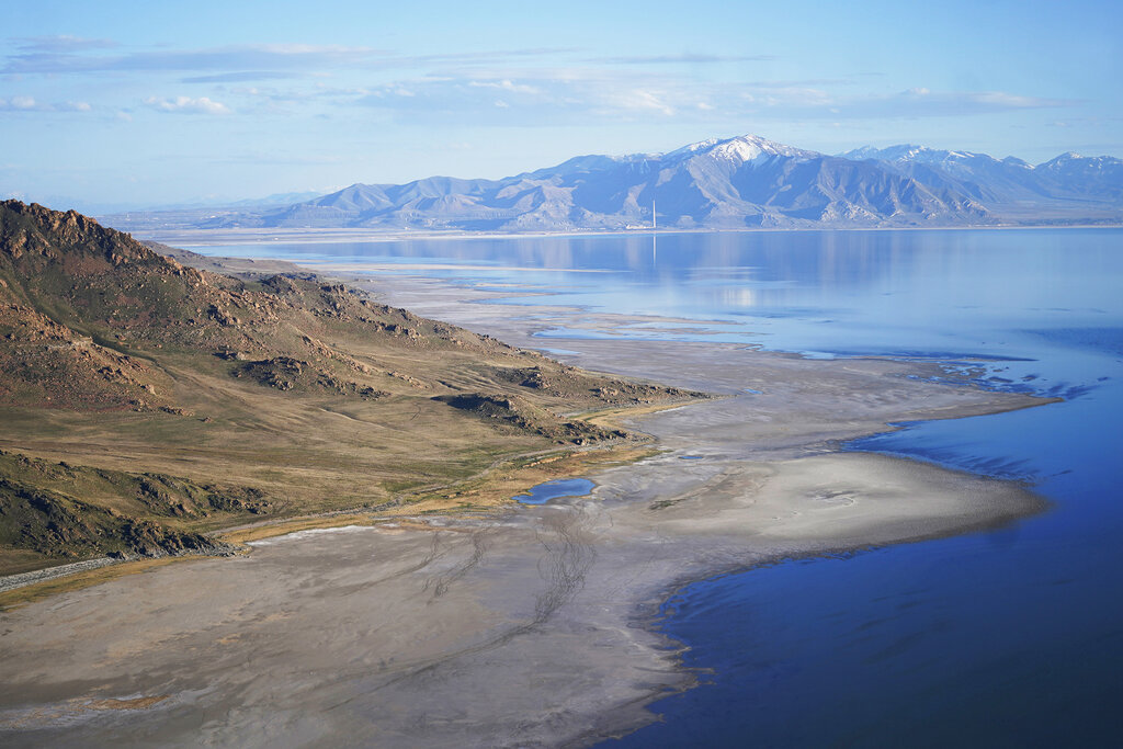 FILE - The Great Salt Lake recedes from Anthelope Island on May 4, 2021, near Salt Lake City. The water levels at the Great Salt Lake have hit a historic low, a grim milestone for the largest natural lake west of the Mississippi River that comes as a megadrought grips the region.