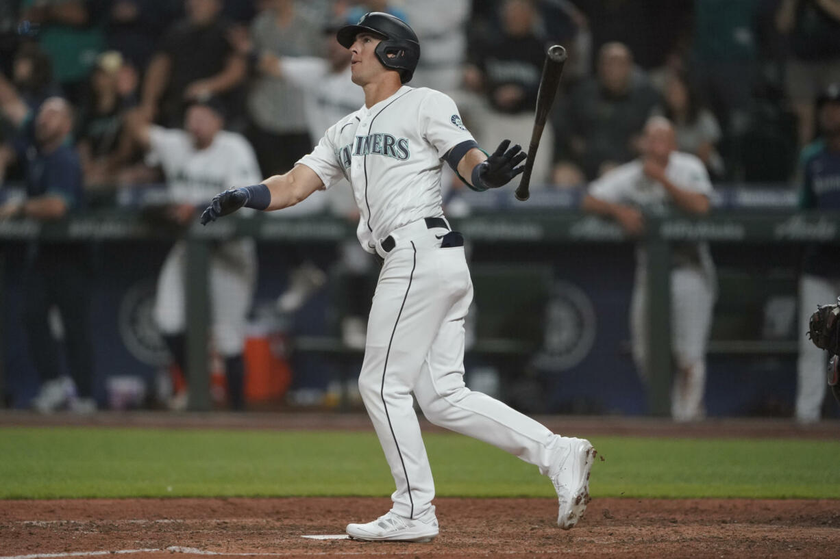 Seattle Mariners' Dylan Moore watches his grand slam during the eighth inning of a baseball game against the Houston Astros, Monday, July 26, 2021, in Seattle. (AP Photo/Ted S.