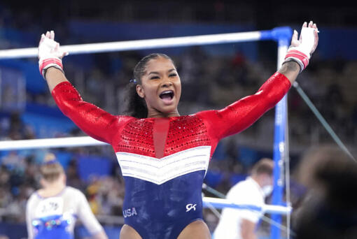 Jordan Chiles, of the United States, celebrates her performance on the uneven bars during the artistic gymnastics women's final at the 2020 Summer Olympics, Tuesday, July 27, 2021, in Tokyo.