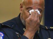 Washington Metropolitan Police Department officer Daniel Hodges wipes his eyes during the House select committee hearing on the Jan. 6 attack on Capitol Hill in Washington, Tuesday, July 27, 2021.