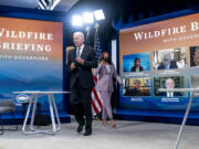 President Joe Biden and Vice President Kamala Harris arrive for a meeting with governors to discuss ongoing efforts to strengthen wildfire prevention, preparedness and response efforts, and hear firsthand about the ongoing impacts of the 2021 wildfire season in the South Court Auditorium in the Eisenhower Executive Office Building on the White House Campus in Washington, Friday, July 30, 2021.