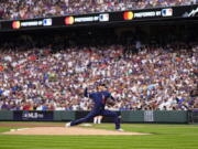 American League's starting pitcher Shohei Ohtani, of the Los Angeles Angeles, throws during the first inning of the MLB All-Star baseball game, Tuesday, July 13, 2021, in Denver.