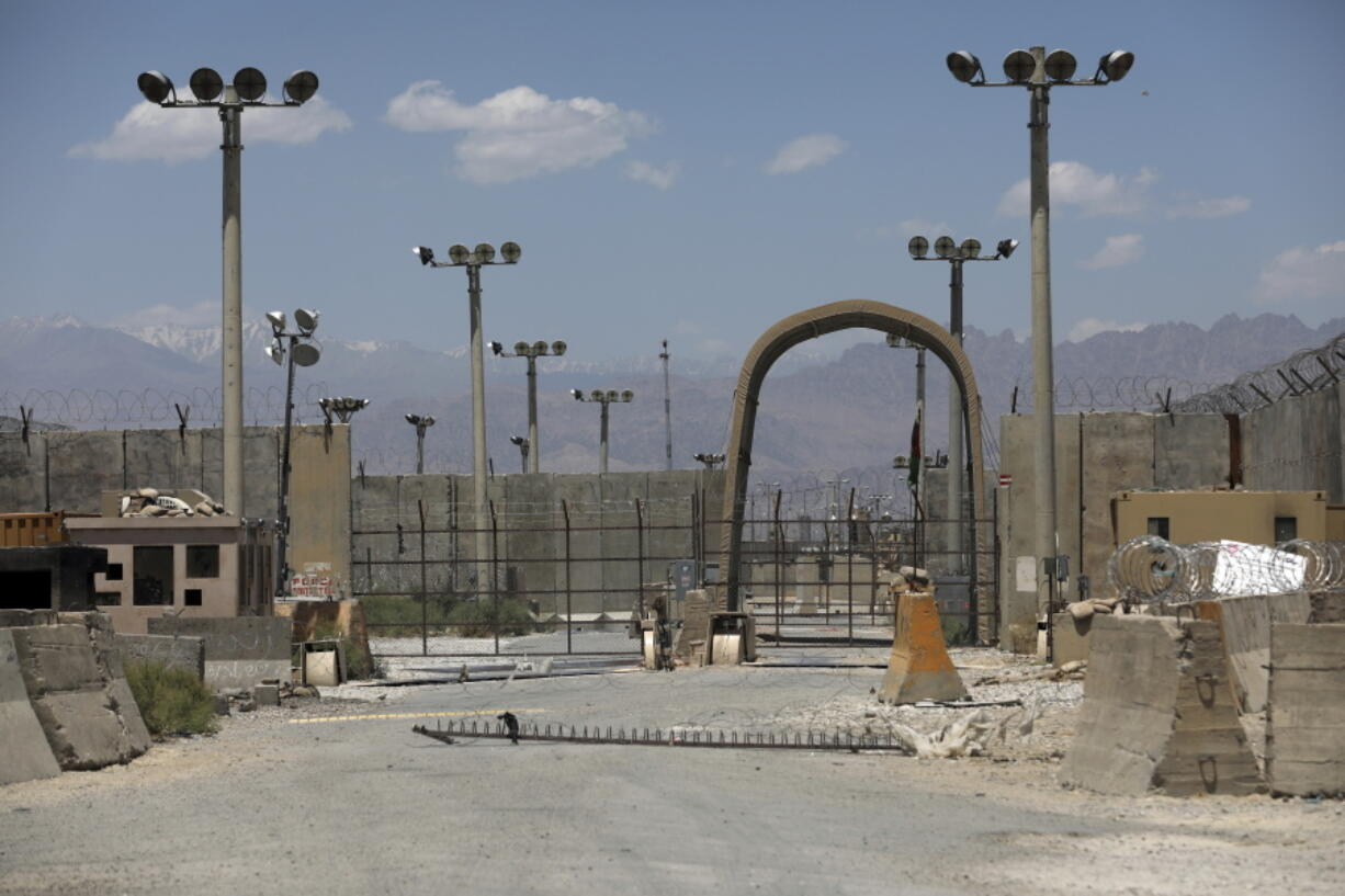 A gate is seen at the Bagram Air Base in Afghanistan, Friday, June 25, 2021.  In 2001 the armies of the world united behind America and Bagram Air Base, barely an hours drive from the Afghan capital Kabul, was chosen as the epicenter of Operation Enduring Freedom, as the assault on the Taliban rulers was dubbed. It's now nearly 20 years later and the last US soldier is soon to depart the base.