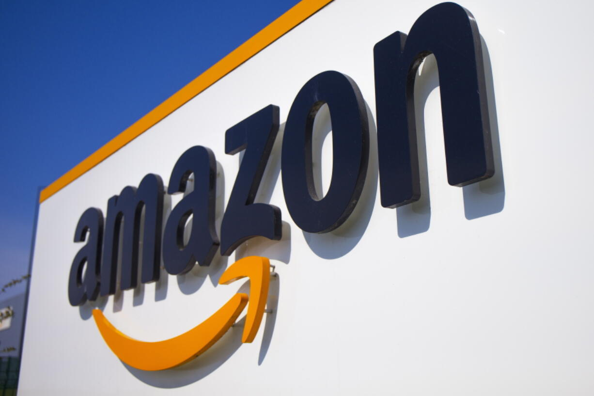 FILE - This April 16, 2020 shows the Amazon logo in Douai, northern France. Amazon on Thursday, July 29, 2021 turned in a mixed bag of results for its fiscal second quarter, coming up short of Wall Street expectations in revenue but beating on profits.