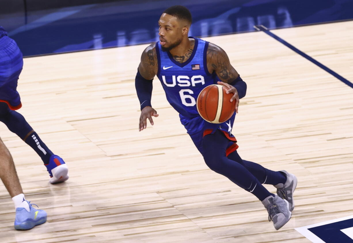 United States' Damian Lillard (6) brings the ball up court against Argentina during the first half of an exhibition basketball game in Las Vegas on Tuesday, July 13, 2021.