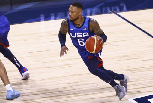 United States' Damian Lillard (6) brings the ball up court against Argentina during the first half of an exhibition basketball game in Las Vegas on Tuesday, July 13, 2021. (Chase Stevens/Las Vegas Review-Journal via AP)