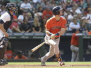Houston Astros' Kyle Tucker watches his two-run home run, next to Seattle Mariners catcher Tom Murphy, during the eighth inning of a baseball game Wednesday, July 28, 2021, in Seattle.