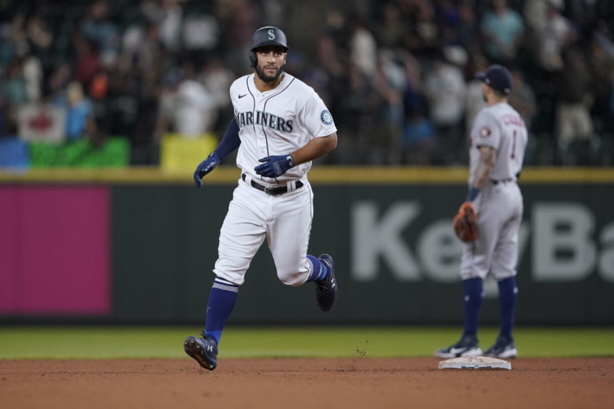 Seattle Mariners' Abraham Toro rounds the bases after hitting a two-run home run against the Houston Astros during the ninth inning of a baseball game, Tuesday, July 27, 2021, in Seattle. Toro was traded to the Mariners from the Astros earlier in the day. The Astros won 8-6. (AP Photo/Ted S.