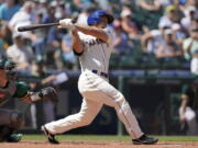 Seattle Mariners' Kyle Seager hits a two-RBI single against the Oakland Athletics during the third inning of a baseball game, Sunday, July 25, 2021, in Seattle. (AP Photo/Ted S.