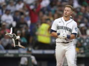 Seattle Mariners' Jarred Kelenic tosses his batting pad after striking out to end the fourth inning of the team's baseball game against the Oakland Athletics, Thursday, July 22, 2021, in Seattle. (AP Photo/Ted S.