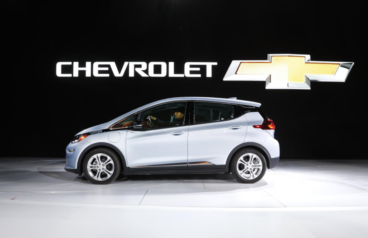 FILE - In this Jan. 9, 2017 file photo the Chevrolet Bolt is on display at the North American International Auto Show in Detroit.  General Motors is recalling some older Chevrolet Bolts, Friday, July 23, 2021, for a second time to fix persistent battery problems that can set the electric cars ablaze.  The recall covers about 69,000 Bolts worldwide from 2017, 2018 and part of the 2019 model year.