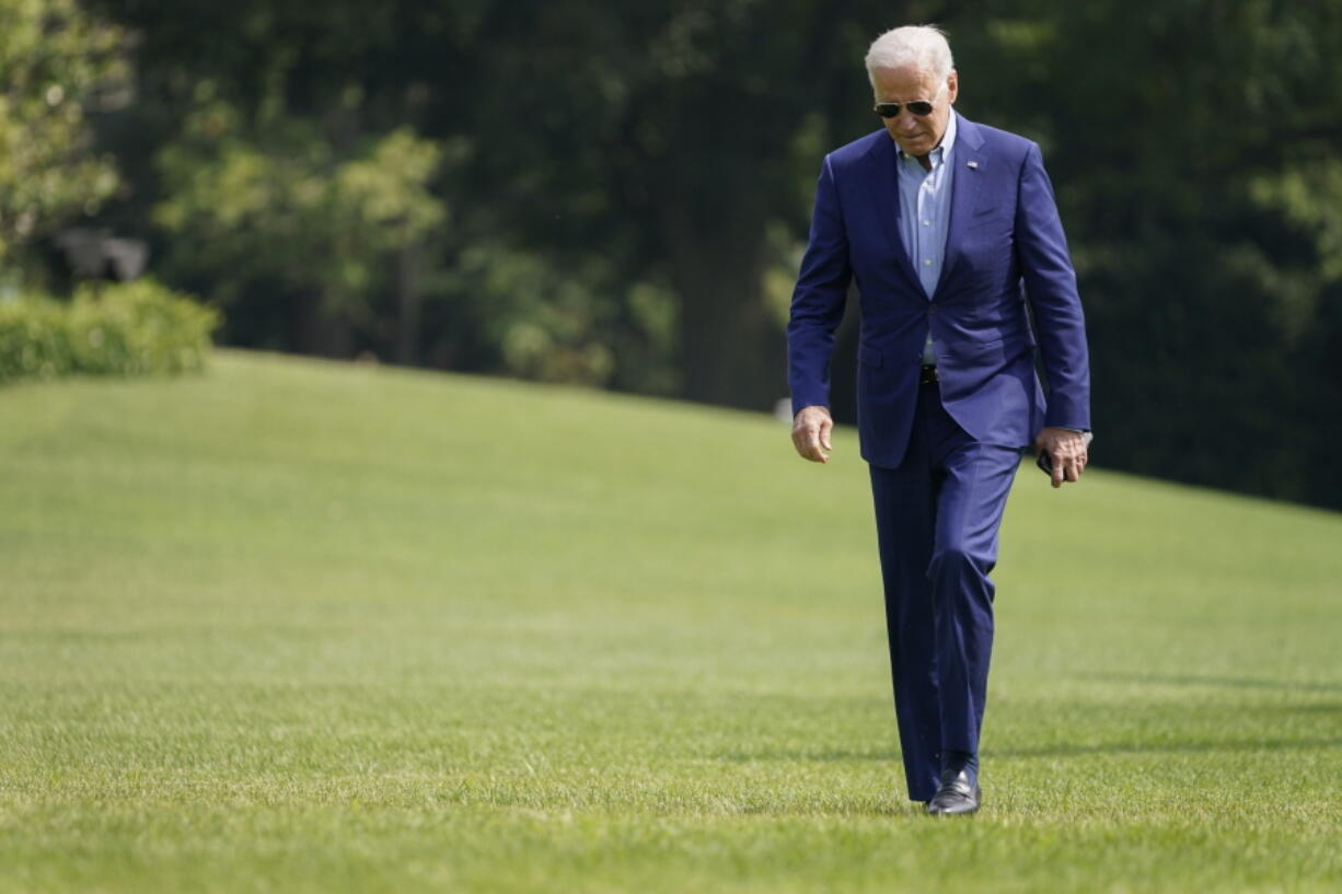 President Joe Biden walks on the South Lawn of the White House after stepping off Marine One, Sunday, July 25, 2021, in Washington. Biden is returning to Washington after spending the weekend in Delaware.
