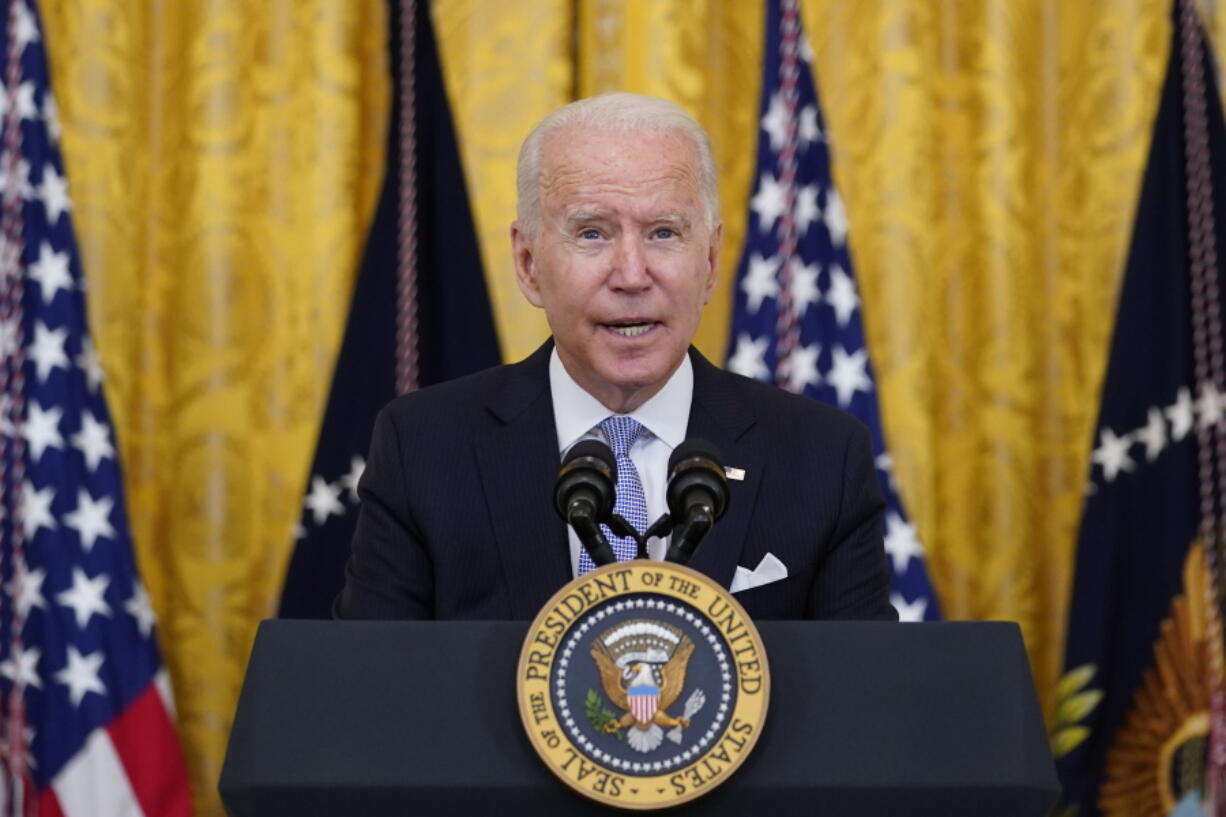 President Joe Biden announces from the East Room of the White House in Washington, Thursday, July 29, 2021, that millions of federal workers must show proof they've received a coronavirus vaccine or submit to regular testing and stringent social distancing, masking and travel restrictions in an order to combat the spread of the coronavirus. A new poll from The Associated Press-NORC Center for Public Affairs Research finds 6 in 10 Democrats say they're optimistic about their party's future. And Democrats nearly universally approve of the way President Joe Biden is handling his job.