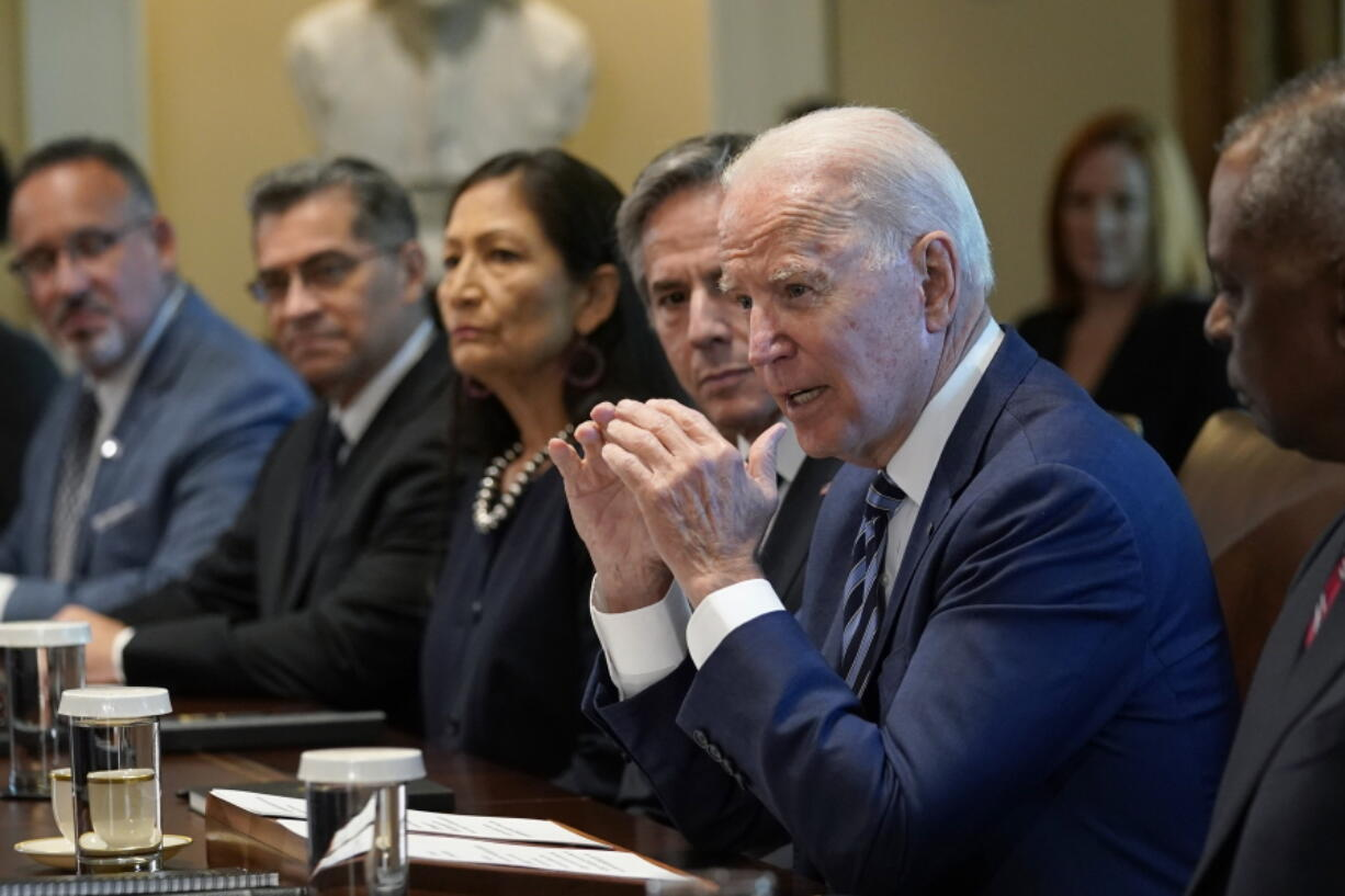 President Joe Biden speaks during a meeting with his Cabinet in the Cabinet Room at the White House in Washington, Tuesday, July 20, 2021. From left, Secretary of Education Miguel Cardona, Secretary of Health and Human Services Xavier Becerra, Secretary of the Interior Deb Haaland, Secretary of State Antony Blinken, Biden and Secretary of Defense Lloyd Austin.