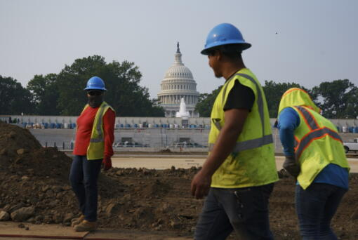 Workers repair a park near the Capitol in Washington, Wednesday, July 21, 2021.  About 8 in 10 Americans favor plans to increase funding for roads, bridges and ports and for pipes that supply drinking water. But a new poll from The Associated Press-NORC Center for Public Affairs Research shows that's about as far as Democrats and Republicans intersect on infrastructure. P (AP Photo/J.