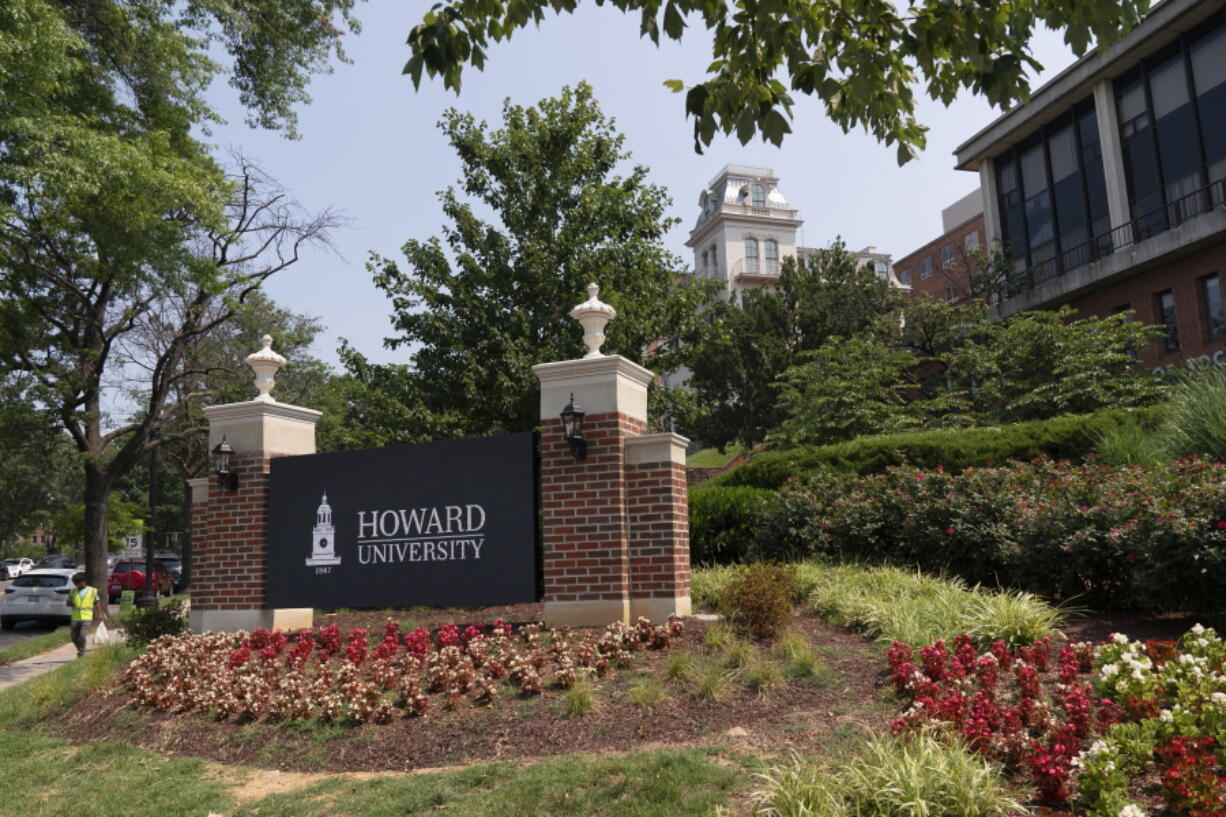 FILE - In this July 6, 2021, file photo, an electronic signboard welcomes people to the Howard University campus in Washington. Two high-profile faculty appointments this week could be a fundraising and enrollment bonanza for Howard University, one of the nation's most prestigious Black colleges.