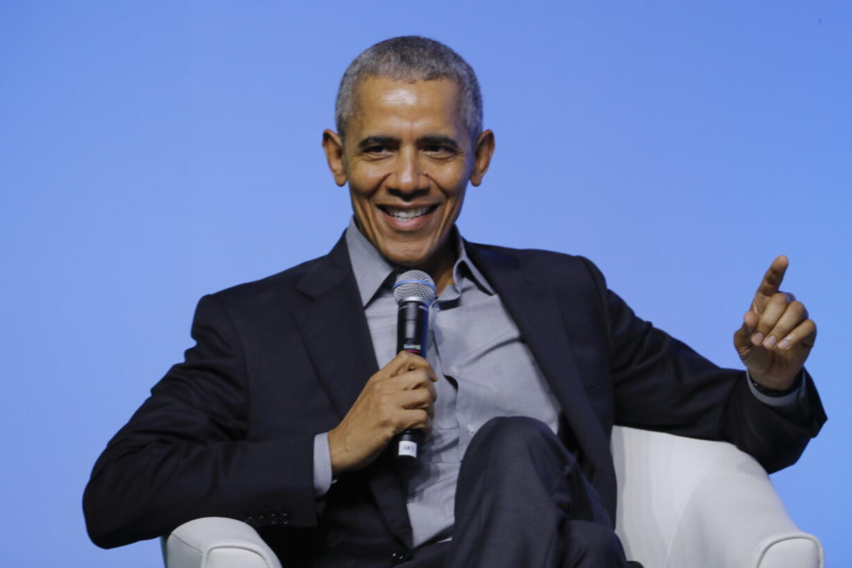 """FILE - Former U.S. President Barack Obama gesture as he attends the """"values-based leadership"""" during a plenary session of the Gathering of Rising Leaders in the Asia Pacific, organized by the Obama Foundation in Kuala Lumpur, Malaysia, on Dec. 13, 2019. Obama's memoir """"Dreams from My Father"""" will be released in a young adult edition on October 5. Obama had yet to hold any political office when """"Dreams from My Father"""" was released in 1995."""