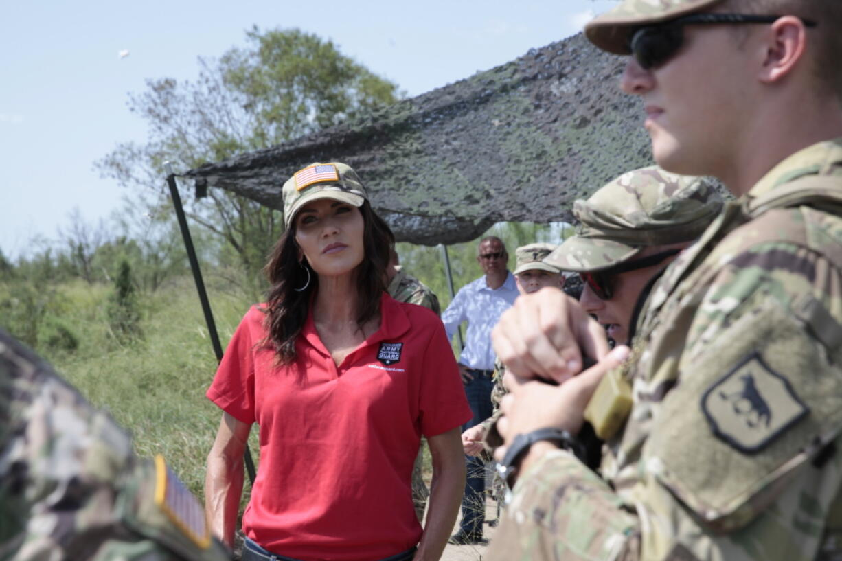 South Dakota Gov. Kristi Noem visits the U.S. border with Mexico on Monday, July 26, 2021, near McAllen, Texas. The Republican governor deployed roughly 50 National Guard troops to help with Texas' push to arrest people crossing illegally and charge them with state crimes.