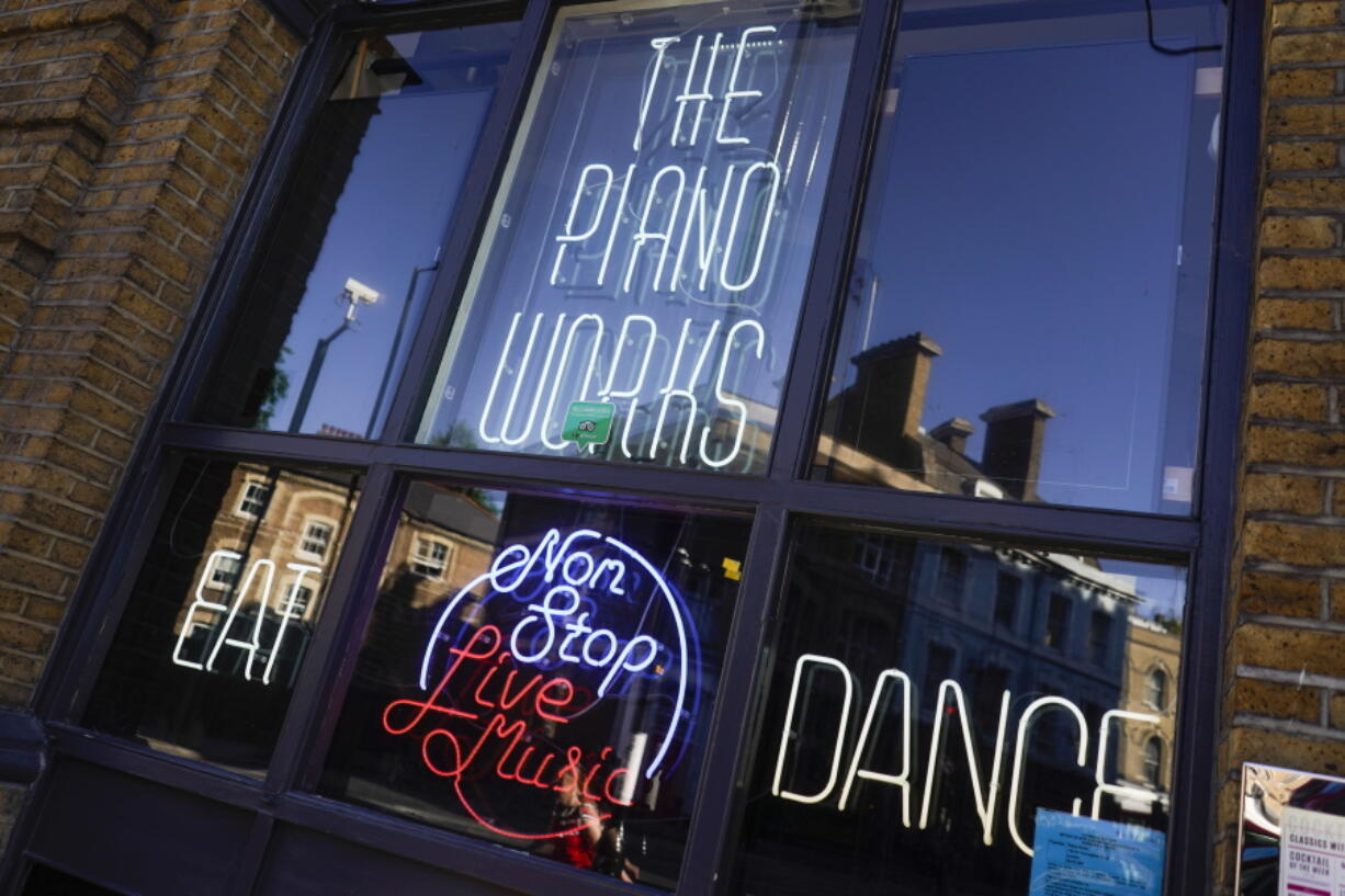 """The Piano Works club in Farringdon, London, Friday, July 16, 2021, ahead of the reopening of nightclubs, as part of the relaxation of COVID-19 restrictions. Thousands of young people plan to dance the night away at """"Freedom Day"""" parties as the clock strikes midnight Monday, when almost all coronavirus restrictions in England are due to be scrapped. Nightclubs can open fully and are not required to use vaccine passports."""