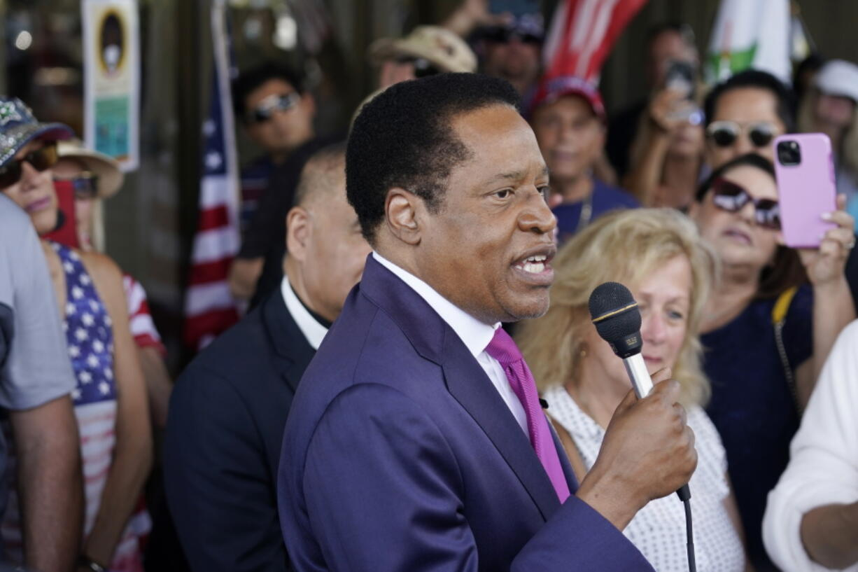 FILE - In this July 13, 2021, file photo, conservative radio talk show host Larry Elder speaks to supporters during a campaign stop in Norwalk, Calif. Elder was not on the list of candidates released Saturday in the recall election that could end the term of California Gov. Gavin Newsom.