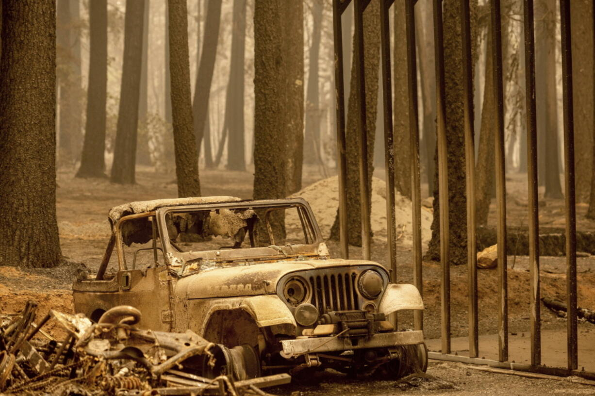 Following the Dixie Fire, a scorched Jeep rests in the Indian Falls community of Plumas County, Calif., on Monday, July 26, 2021.