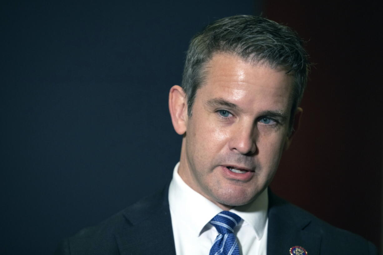 """FILE - In this May 12, 2021 file photo, Rep. Adam Kinzinger, R-Ill., speaks to the media at the Capitol in Washington. House Speaker Nancy Pelosi said Sunday, July 25 she intends to name Kinzinger to a congressional committee investigating the violent Jan. 6 Capitol insurrection, pledging that the panel will """"find the truth"""" even as the GOP threatens to boycott the effort."""