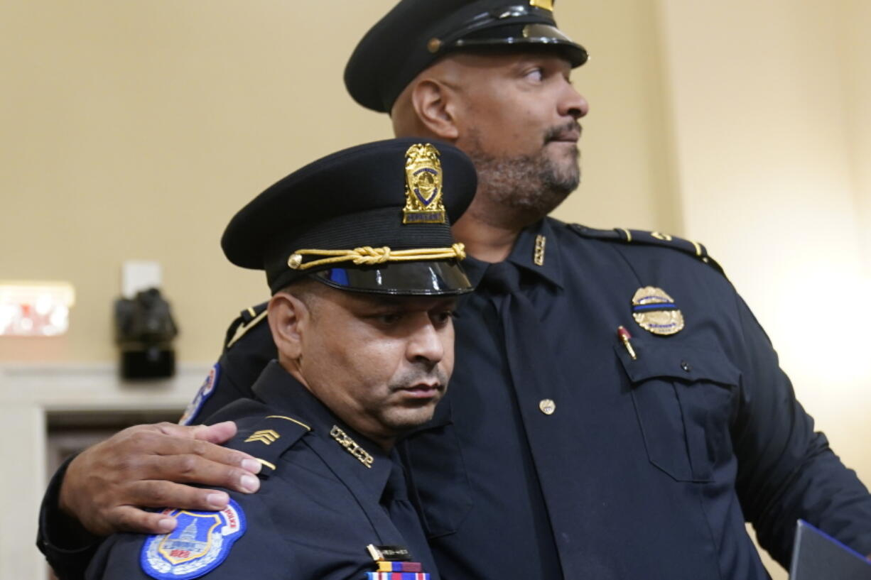 U.S. Capitol Police Sgt. Aquilino Gonell left, and U.S. Capitol Police Sgt. Harry Dunn stand after the House select committee hearing on the Jan. 6 attack on Capitol Hill in Washington, Tuesday, July 27, 2021.
