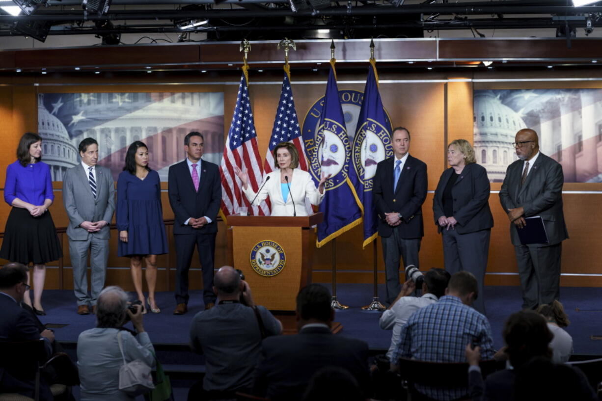 Speaker of the House Nancy Pelosi, D-Calif., announces Democratic appointments to a new select committee to investigate the violent Jan. 6 insurrection at the Capitol, on Capitol Hill in Washington, Thursday, July 1, 2021. From left are Rep. Elaine Luria, D-Va., Rep. Jamie Raskin, D-Md., Rep. Stephanie Murphy, D-Fla., Rep. Pete Aguilar, D-Calif., Rep. Adam Schiff, D-Calif., Rep. Zoe Lofgren, D-Calif., and Rep. Bennie Thompson D-Miss., who will lead the panel. Rep. Liz Cheney, R-Wyo., who was ousted from the GOP leadership for criticizing Trump, accepted Pelosi's invitation to join the committee. (AP Photo/J.