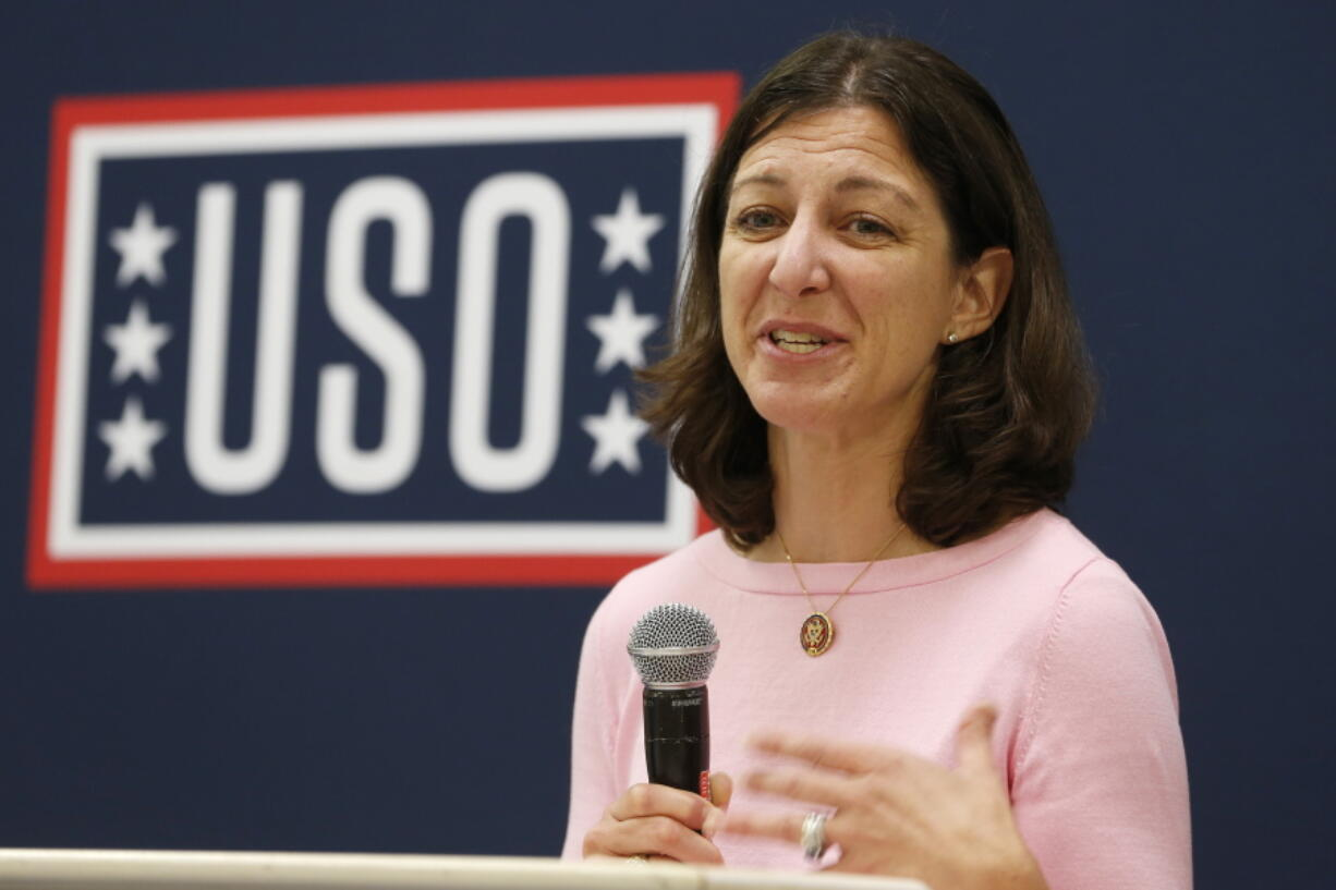 FILE - In this Oct. 4, 2019, file photo Rep. Elaine Luria, D-Va., speaks to participants in a USO Pathfinder program in Virginia Beach, Va.  Luria has built a reputation as pro-military and proud moderate in one of the nation's most Navy- and Defense Department-dependent swing districts. But she's also agreed to join a House committee investigating the deadly Jan. 6 insurrection at the U.S. Capitol, which could raise uncomfortable questions about links between the military and extremist groups and test her centrist credentials.
