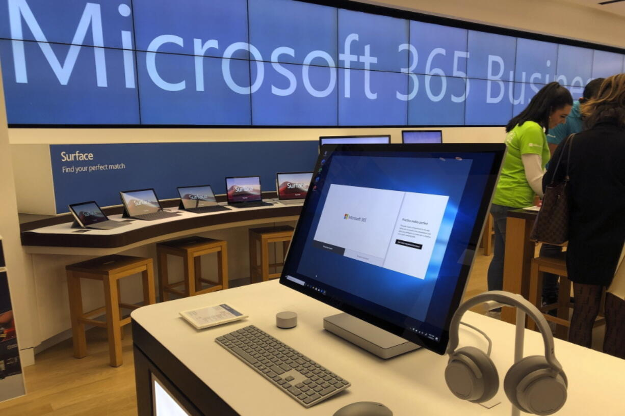 FILE - In this Jan. 28, 2020, file photo, a Microsoft computer is among items displayed at a Microsoft store in suburban Boston. The Biden administration on Monday, July 19, 2021, blamed China for a hack of Microsoft Exchange email server software that compromised tens of thousands of computers around the world earlier in the year.