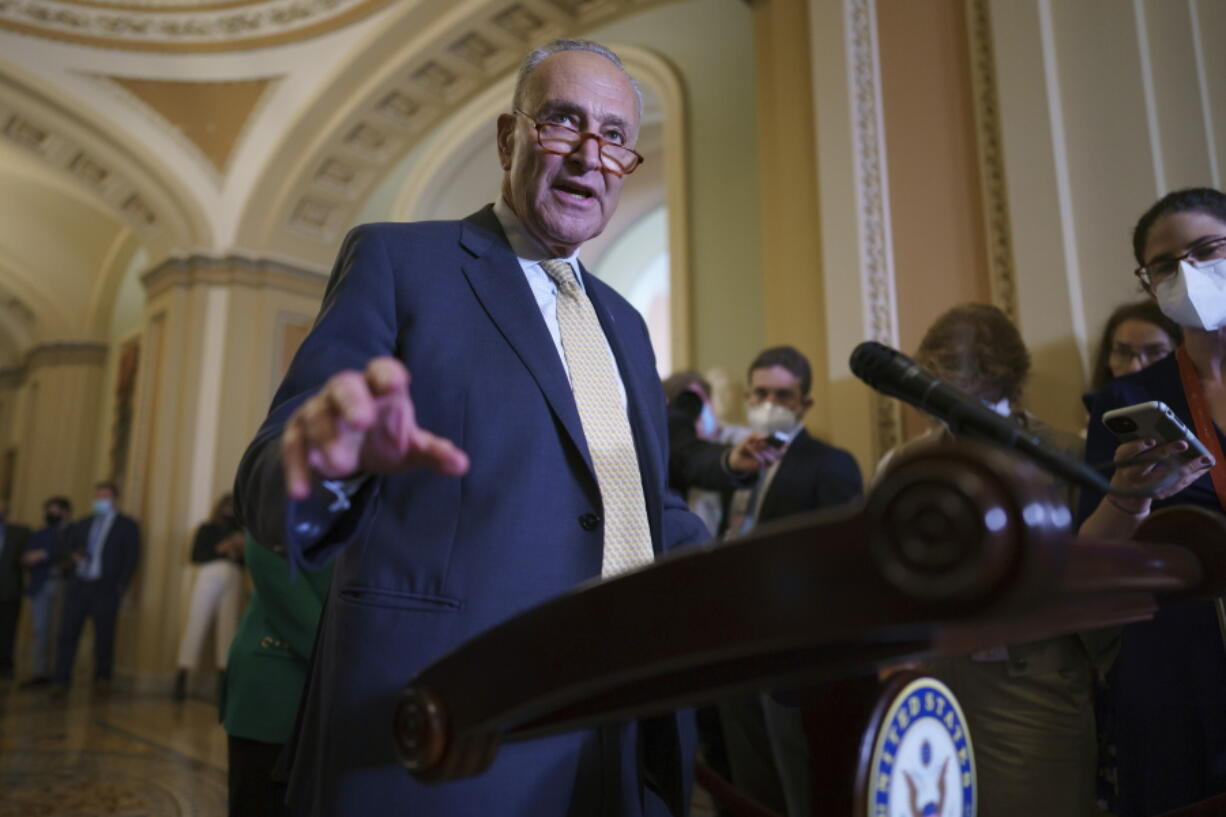 Senate Majority Leader Chuck Schumer, D-N.Y., speaks to reporters as intense negotiations continue to salvage a bipartisan infrastructure deal, at the Capitol in Washington, Tuesday, July 27, 2021. (AP Photo/J.