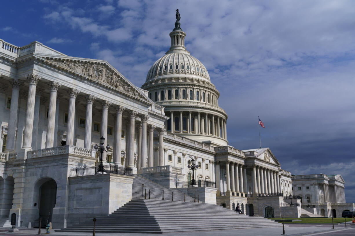 FILE - In this July 1, 2021, file photo shows the Capitol in Washington. Senators negotiating two colossal bills delivering $4 trillion for bolstering infrastructure, health care, environment and other initiatives keep insisting both measures will be fully paid for.  (AP Photo/J.