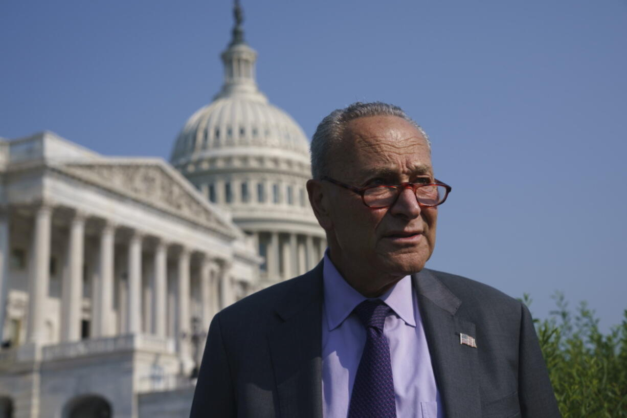 Senate Majority Leader Chuck Schumer, D-N.Y., arrives to meet with Speaker of the House Nancy Pelosi, D-Calif., before an event to promote investments in clean jobs, at the Capitol in Washington, Wednesday, July 28, 2021. (AP Photo/J.