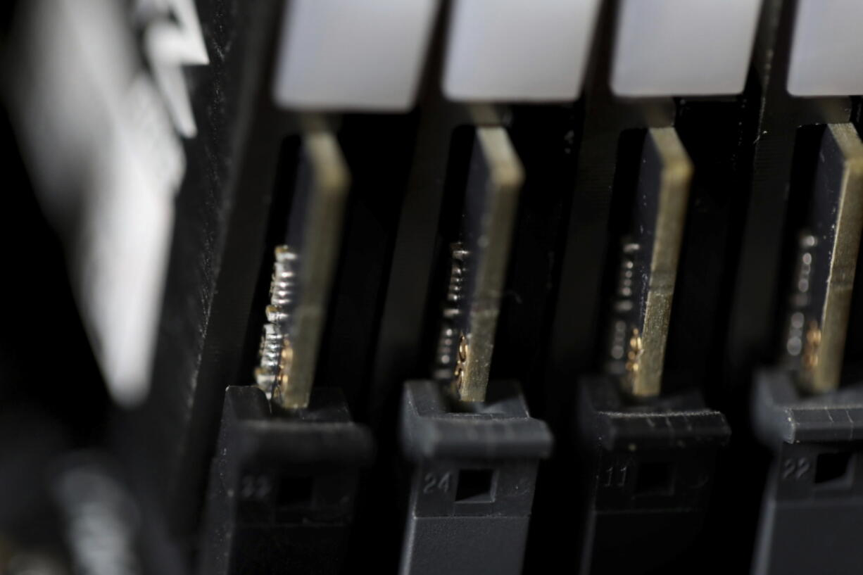 FILE - This Feb 23, 2019, file photo shows the inside of a computer in Jersey City, N.J. The Biden administration will offer rewards up to $10 million for information leading to the identification of foreign state-sanctioned malicious cyber activity against critical U.S. infrastructure, including ransomware attacks. The administration is launching the website stopransomware.gov to offer the public resources for countering the threat.